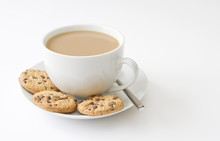 Cup Of Tea And Cookies On White Background