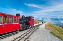 Cog Railway Train Climbing Up To The Mountain
