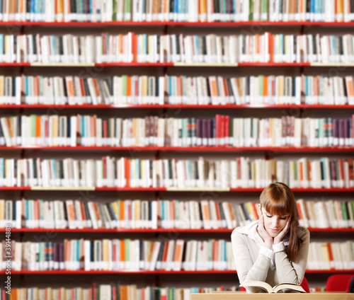 Fotografie, Obraz  Young student in a library