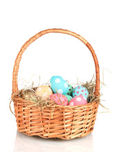Colorful Easter Eggs In The Basket  Isolated On White
