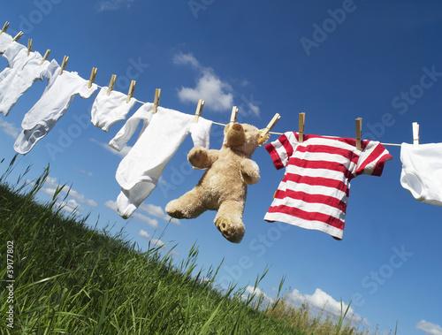 Fotografia, Obraz  Baby clothing on a clothesline