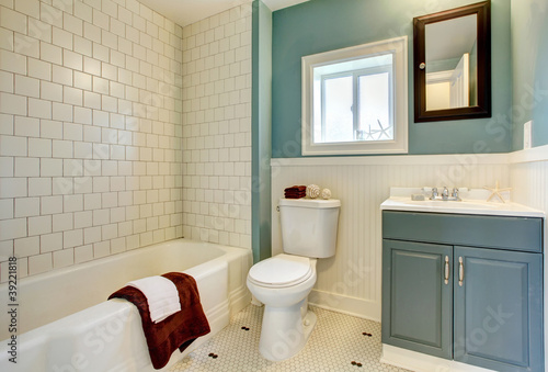 Valokuva  New remodeled blue bathroom with classic white tile.