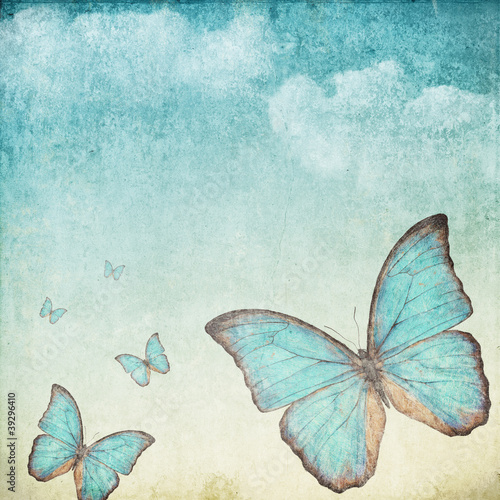 Poster Butterflies in Grunge Vintage background with a blue butterfly