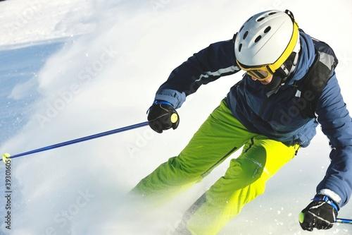 Canvas Print skiing on fresh snow at winter season at beautiful sunny day