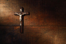 Crucifix On Wooded Wall