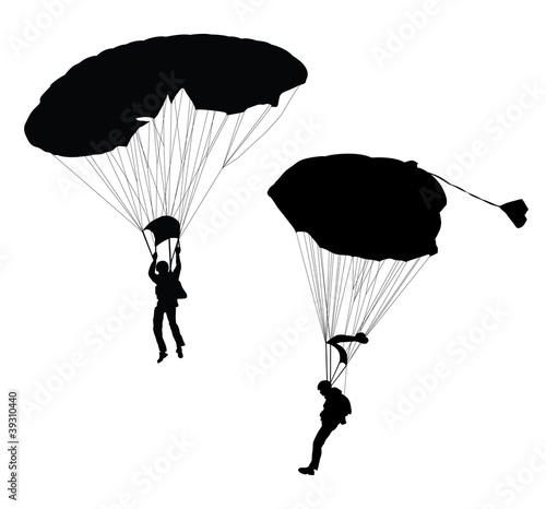 Photo Vector silhouette of skydiver before landing