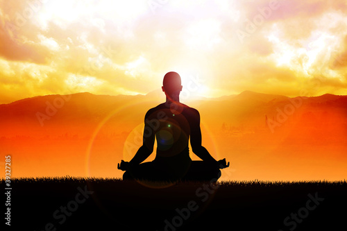 Tuinposter Boeddha Silhouette of a man figure meditating in the outdoors