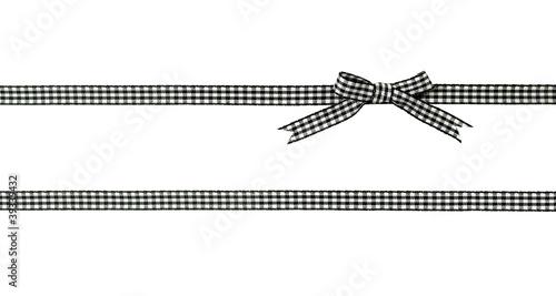 Fototapeta  noeud de ruban vichy noir et blanc