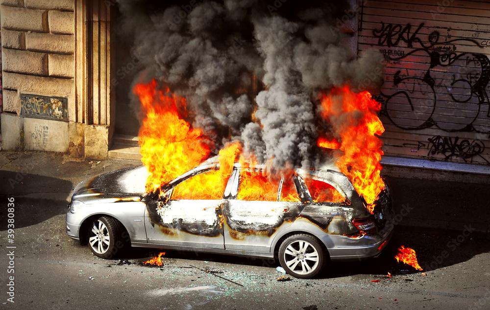 Fototapeta Riot - Burnt out Car