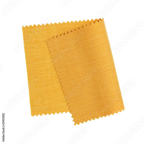 Tuinposter Stof Yellow fabric sample isolated on white background