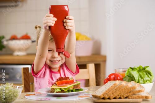 Fototapeta little girl with sandwich obraz