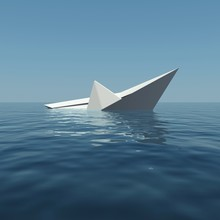 Paper Boat Is Sinking Into The...