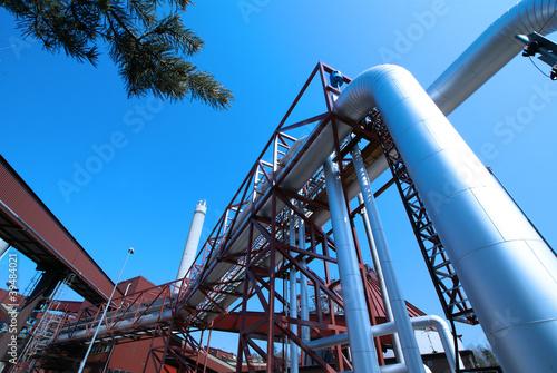 Staande foto Industrial geb. Industrial zone, installation of Steel pipelines and cables in b