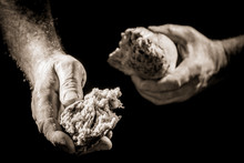Human Hand Sharing With Bread As Charitable Action