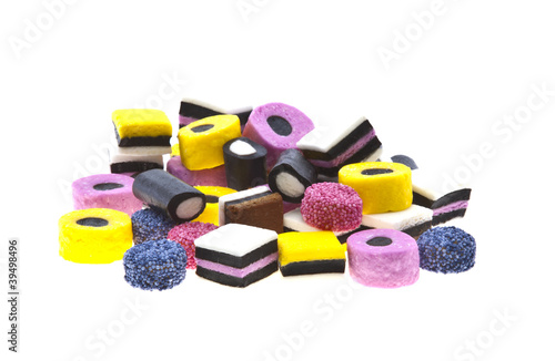 Poster Confiserie Selection of liquorice sweets in colourful abstract stack design