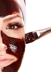 Panel Szklany Do Spa Girl having chocolate facial mask.