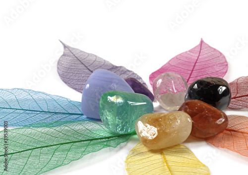 Photo  Close up of gemstones on colour leaves
