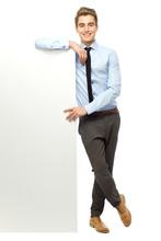 Businessman Leaning Against Blank Billboard