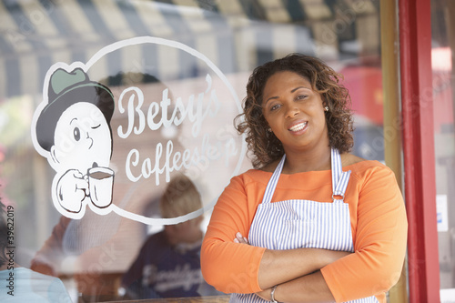 Portrait of woman in front of coffee shop