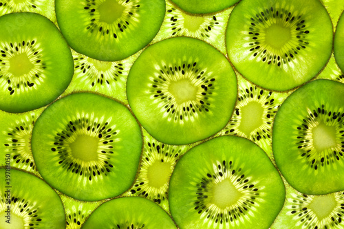 Photo Stands Slices of fruit Fresh Kiwi pattern / background / back lit