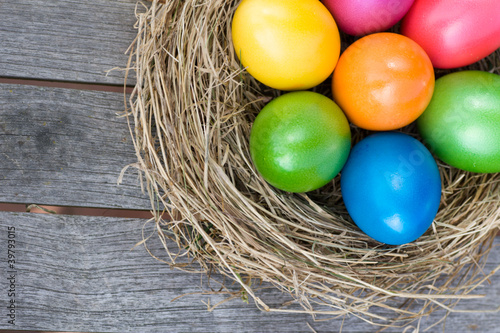Fotografia  Easter basket with colored eggs