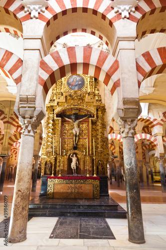 Fotografie, Obraz  Arabic arches framing a christian altar in Corodoba's mosque