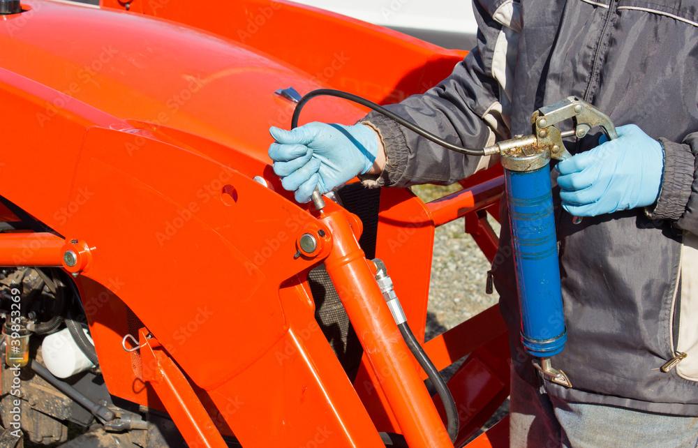 Fototapety, obrazy: Greasing Tractor Piston