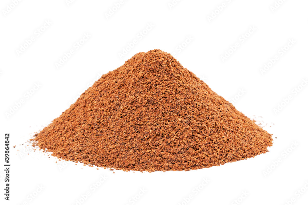 Fototapeta Heap of ground Cinnamon isolated on white background.