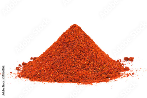 Fotografía  Pile of ground Paprika isolated on white background.