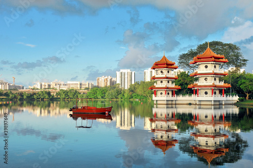 Pagodas beside a lake in Singapore Poster