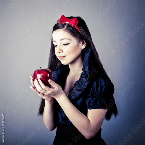 Fotografie, Obraz  fantasy portrait of the beautiful Snow White with an apple