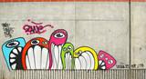 Fototapeta Młodzieżowe - Graffiti sur béton