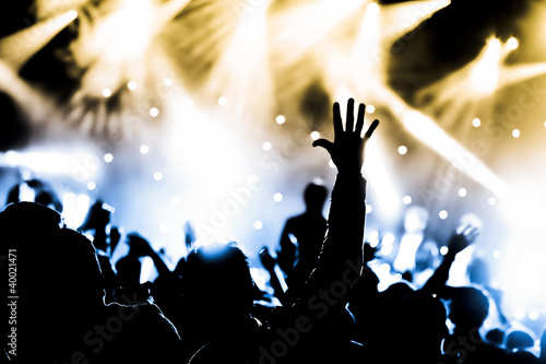 Photo crowd with hands raised at a live music concert