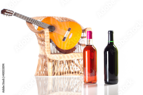 Foto op Plexiglas Bar Rose and red wine bottle with a guitar on background