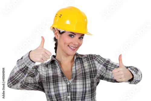 Valokuva  Smiling tradeswoman giving two thumb's up
