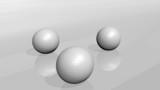 3 white golf balls