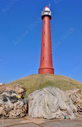 Fotografie, Obraz  Lighthouse IJmuiden (Netherlands). In the foreground fishing net
