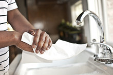 Hands Drying On Paper Cloth