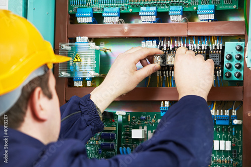 Fotografia, Obraz  Electrician at safety fuse device replace work