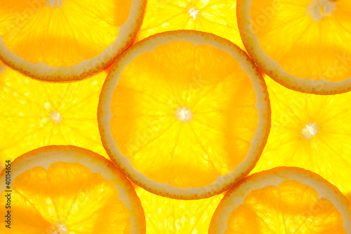 La pose en embrasure Tranches de fruits Orange slices background / macro / back lit
