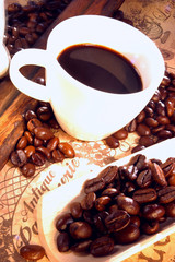 Fototapeta Do kawiarni Black coffee with coffee beans