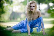 Beauty Blond Lady In Garden
