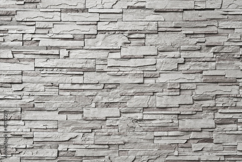 Fototapeta The gray modern stone wall