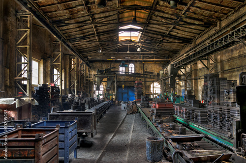 Foto op Aluminium Oude verlaten gebouwen Factory hall in the old iron foundry