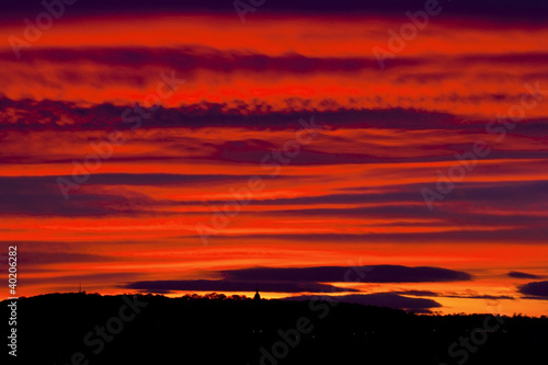 Keuken foto achterwand Rood traf. Picturesque red sunset sky with clouds