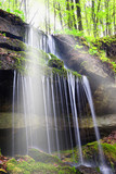 sunbeam over the waterfall in the forest - 40228690