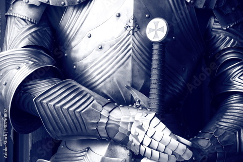 Ancient metal armor in sepia. Canvas Print