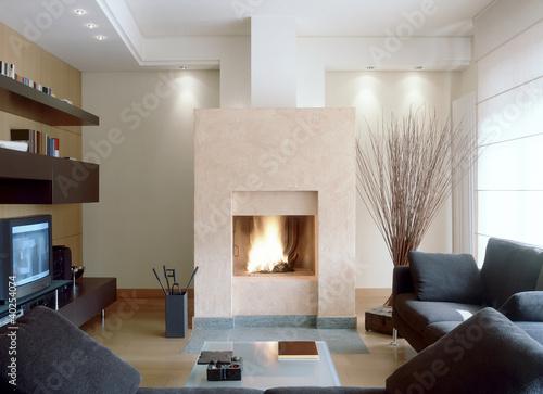 camino in moderno soggiorno con divano grigio - Buy this stock photo ...
