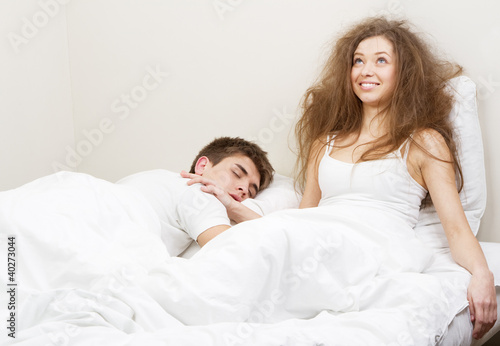 Fotografie, Obraz  Young couple in bed