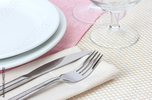 Table setting with fork knife plates and napkin & Table setting with fork knife plates and napkin - Buy this stock ...